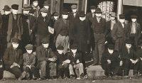 Photo: Men wearing surgical masks in Shelby, Nebraska, December 8, 1918. History Nebraska RG2017.PH